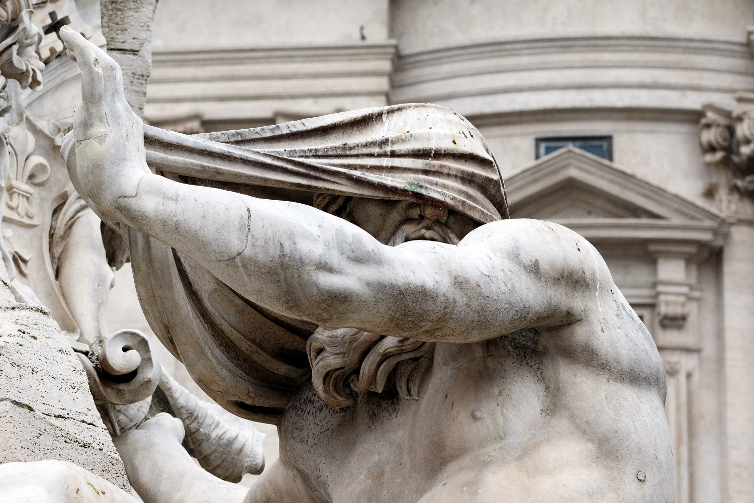 Sculpture detail of the Nile River god in The Fountain of the Four Rivers (The Fontana dei Quattro Fiumi) in the Piazza Navona in Rome, Italy. Monument was built by Gian Lorenzo Bernini in 1651.